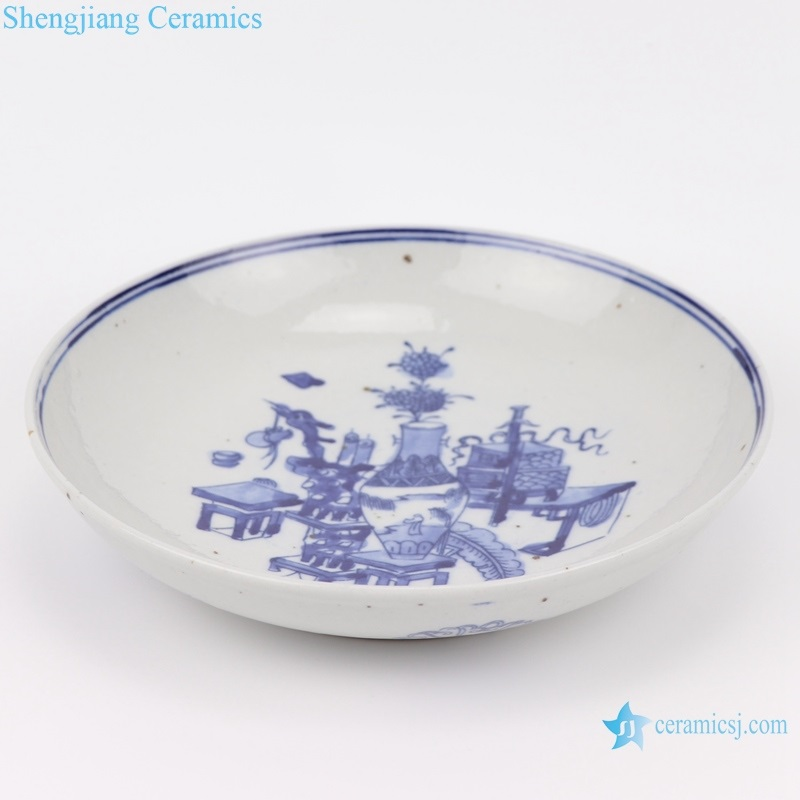 blue and white archaize plate top view