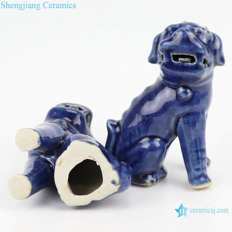 Deep blue poodle siting pattern statue bottom view
